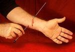 Needle thru arm
